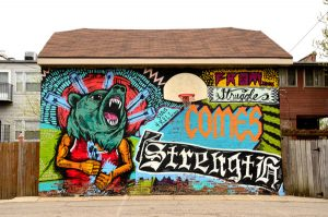 """This mural was painted by artist Sentrock on a garage in North Lawndale. Titled """"From Struggle Comes Strength,"""" it embodies the spirit of the neighborhood. (Credit: Tiffany Huang)"""